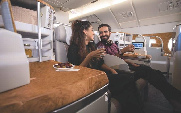 indian-couple-on-business-class-w768x480